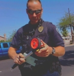 City of Tempe Police read a measuring wheel to determine photo radar sign distances on 10/9/2009.